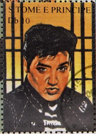 send to prison: SAO TOME AND PRINCIPE - CIRCA 1995: A stamp printed in Sao Tome and Principe shows image portrait of famous American singer Elvis Presley (1935-1977), circa 1995.