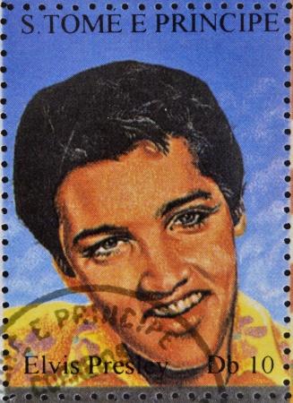 commemorate: SAO TOME AND PRINCIPE - CIRCA 1995: A stamp printed in Sao Tome and Principe shows image portrait of famous American singer Elvis Presley (1935-1977), circa 1995.