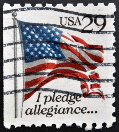 allegiance: UNITED STATES OF AMERICA - CIRCA 1992: a stamp printed in the USA shows USA Flag, I Pledge of Allegiance, circa 1992  Stock Photo