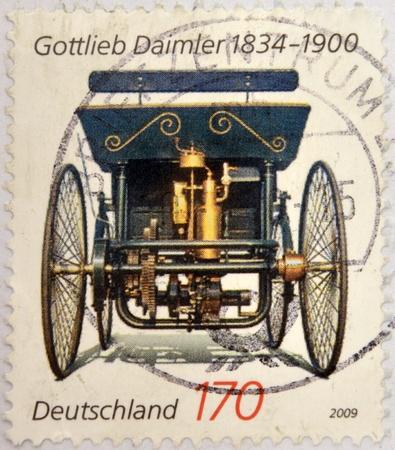 daimler: GERMANY - CIRCA 2009: Stamp printed in germany shows Gottlieb Daimler, old car, circa 2009