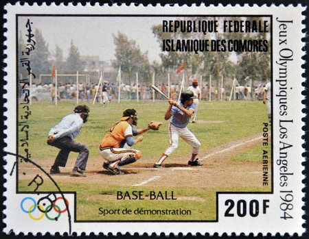 comores: COMORES - CIRCA 1984: A stamp printed in Comores dedicated to the Olympic Games in Los Angeles 1984, shows baseball, circa 1984  Editorial