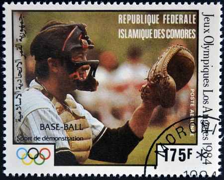 COMORES - CIRCA 1984: A stamp printed in Comores dedicated to the Olympic Games in Los Angeles 1984, shows baseball, circa 1984