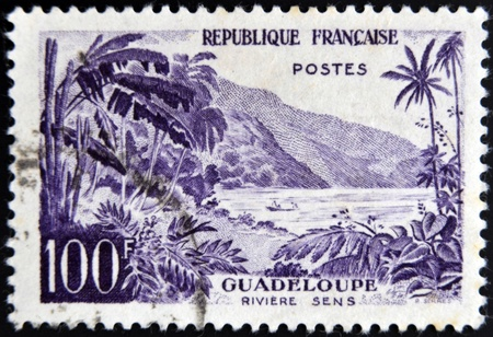 sens: FRANCE - CIRCA 1957: stamp printed in France shows Guadeloupe, Sens river, circa 1957