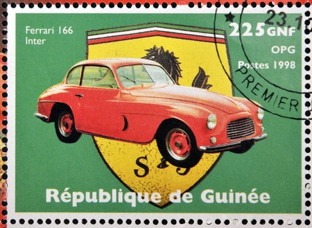 GUINEA - CIRCA 1998: Stamp printed in Guinea dedicated to anniversary of Enzo Ferrari, shows Ferrari 166 Inter, circa 1998