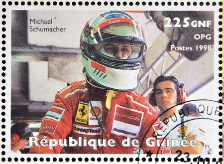 michael schumacher: GUINEA - CIRCA 1998: Stamp printed in Guinea dedicated to anniversary of Enzo Ferrari, shows Michael Schumacher, circa 1988 Editorial