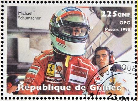 GUINEA - CIRCA 1998: Stamp printed in Guinea dedicated to anniversary of Enzo Ferrari, shows Michael Schumacher, circa 1988 Editorial