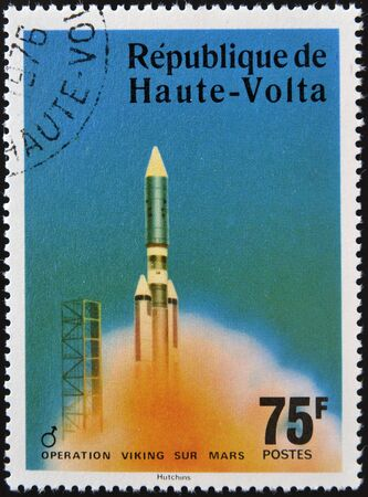 sur: UPPER VOLTA - CIRCA 1976: A stamp printed in Upper Volta dedicated to Operation Viking Sur Mars, circa 1975.