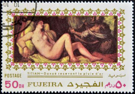 fujeira: FUJEIRA - CIRCA 1985  Stamp printed in Fujeira shows Danae by Tintoretto, circa 1985