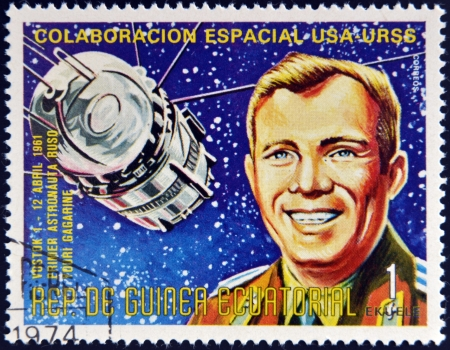 yuri: EQUATORIAL GUINEA - CIRCA 1974: A stamp printed in Guinea shows Vostok1 and Yuri Gagarin, Apollo-Soyuz Space Project, circa 1974