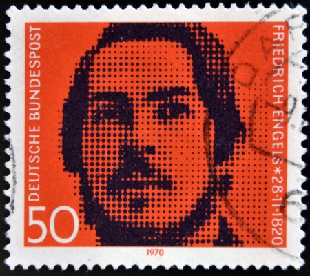collaborator: GERMANY - CIRCA 1970: stamp printed in Germany shows Friedrich Engels, socialist, collaborator with Karl Marx, circa 1970