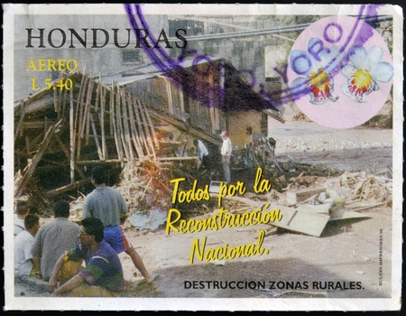 HONDURAS - CIRCA 1998: A stamp printed in Honduras dedicated to rural reconstruction of destroyed, circa 1998