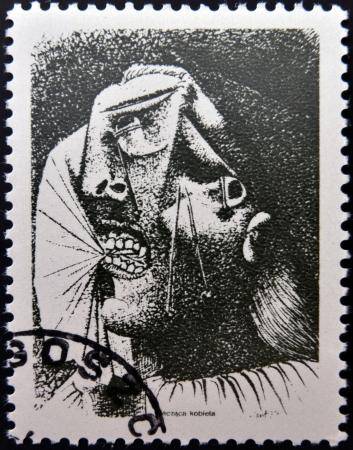 Polonia - alrededor de 1981: Un sello impreso en Polonia muestra a una mujer llorando por Pablo Picasso, alrededor del año 1981