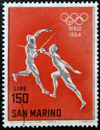 SAN MARINO - CIRCA 1964: A stamp printed in San Marino shows fencing, 18th Olympic Games, Tokyo, circa 1964