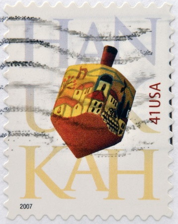 UNITED STATES OF AMERICA - CIRCA 2007: A stamp printed in USA dedicated to Hanukkah shows Dreidel, circa 2007 Stock Photo - 19618499