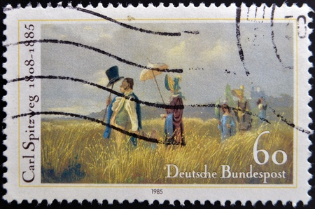 postoffice: GERMANY - CIRCA 1985: stamp printed in Germany shows The Sunday Walk by Carl Spitzweg, circa 1985.  Stock Photo