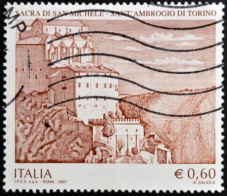 sacra: ITALY - CIRCA 2007 - A stamp printed in Italy shows the gothic abbey Sacra di San Michele, SantAmbrogio, near Turin, in Italy, circa 2007