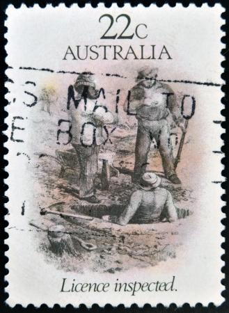 gold rush: AUSTRALIA - CIRCA 1981  A stamp printed in Australia dedicated to the gold rush era, shows license inspected, circa 1981