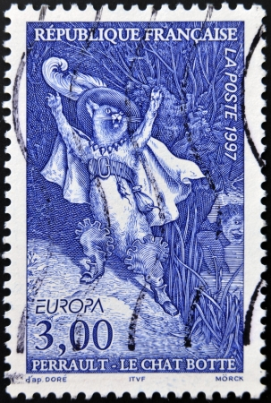 rapier: FRANCE - CIRCA 1997: A stamp printed in France shows Puss in Boots, Perrault tale, circa 1997