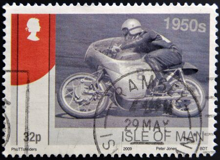 ISLE OF MAN - CIRCA 2009: A stamp printed in Isle of Man dedicated to racing motorcycles of the 50, circa 2009