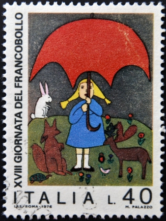 ITALY - CIRCA 1976: stamp printed in Italy shows Girl and animals by children drawing, circa 1976 photo