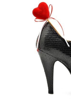 black shoe heel woman with red heart photo