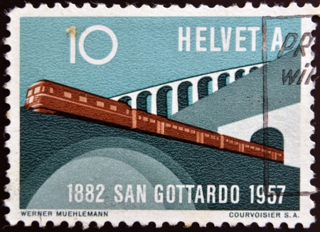viaducts: SWITZERLAND - CIRCA 1957: A stamp printed in Switzerland shows train leaving the tunnel, circa 1957