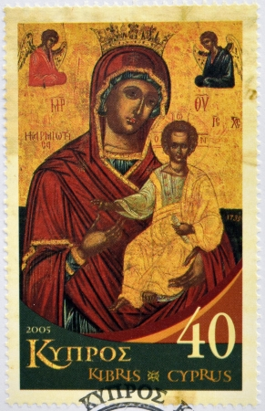 CYPRUS - CIRCA 2005: A stamp printed in Cyprus shows The Virgin Mary Karmiotissa, from the church with the same name in the village of Karmi, circa 2005 photo