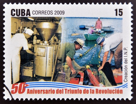 fisheries: CUBA - CIRCA 2009: A stamp printed in cuba dedicated to 50 anniversary of the triumph of the revolution, shows creation of the National Fisheries Institute, circa 2009  Editorial