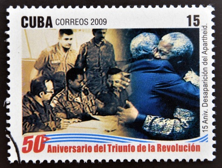 CUBA - CIRCA 2009: A stamp printed in cuba dedicated to 50 anniversary of the triumph of the revolution, shows anniversary of the demise of apartheid, embrace between Fidel and Mandela, circa 2009