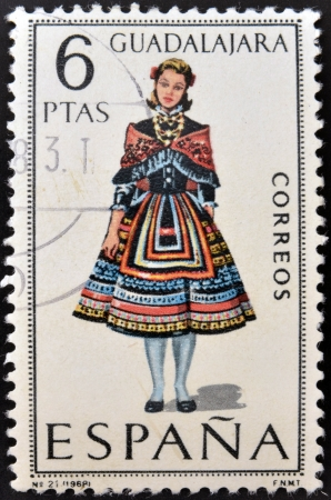 SPAIN - CIRCA 1968: A stamp printed in Spain dedicated to Provincial Costumes shows a woman from Guadalajara, circa 1968 Stock Photo - 20009945
