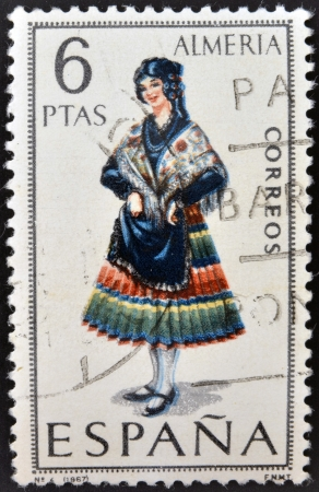 SPAIN - CIRCA 1967: A stamp printed in Spain dedicated to Provincial Costumes shows a woman from Almeria, circa 1967 Stock Photo - 20009646