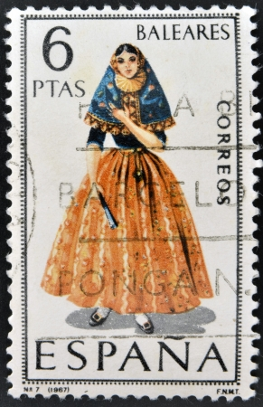 SPAIN - CIRCA 1967: A stamp printed in Spain dedicated to Provincial Costumes shows a woman from Balearic Islands, circa 1967 Stock Photo - 20009532