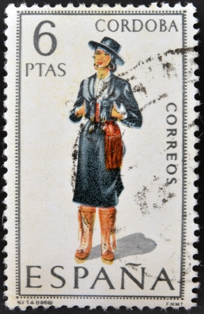 SPAIN - CIRCA 1968: A stamp printed in Spain dedicated to Provincial Costumes shows a woman from Cordoba, circa 1968 Stock Photo - 20009543