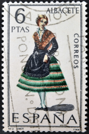 SPAIN - CIRCA 1967: A stamp printed in Spain dedicated to Provincial Costumes shows a woman from Albacete, circa 1967 Stock Photo - 20002921