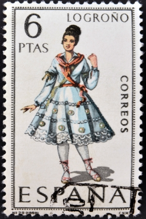 SPAIN - CIRCA 1969: A stamp printed in Spain dedicated to Provincial Costumes shows a woman from Logroño, circa 1969 Stock Photo - 20009936