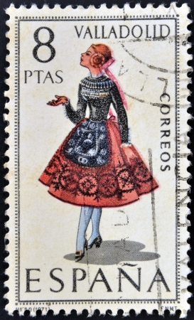 SPAIN - CIRCA 1971: A stamp printed in Spain dedicated to Provincial Costumes shows a woman from Valladolid, circa 1971 Stock Photo - 20009658