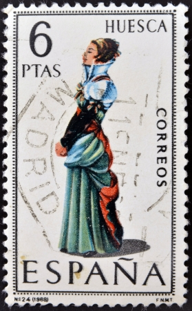 SPAIN - CIRCA 1968: A stamp printed in Spain dedicated to Provincial Costumes shows a woman from Huesca, circa 1968 Stock Photo - 20009946