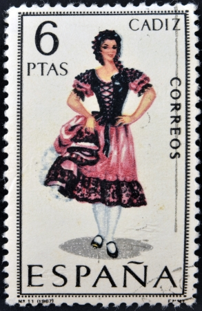 SPAIN - CIRCA 1967: A stamp printed in Spain dedicated to Provincial Costumes shows a woman from Cadiz, circa 1967 Stock Photo - 20010089