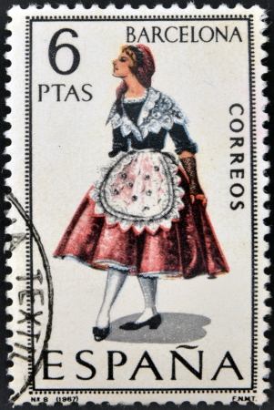 SPAIN - CIRCA 1967: A stamp printed in Spain dedicated to Provincial Costumes shows a woman from Barcelona, circa 1967  Stock Photo - 20009541