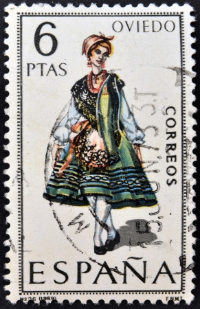 SPAIN - CIRCA 1969: A stamp printed in Spain dedicated to Provincial Costumes shows a woman from Oviedo, circa 1969
