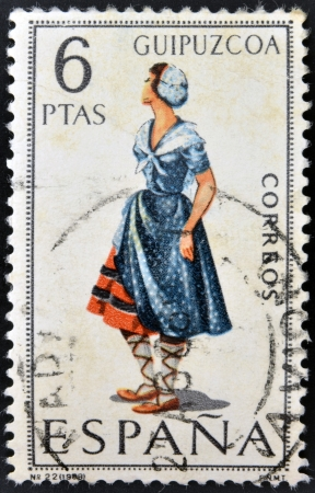 SPAIN - CIRCA 1968: A stamp printed in Spain dedicated to Provincial Costumes shows a woman from Guipuzcoa, circa 1968 Stock Photo - 20009948