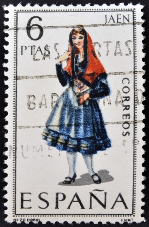 SPAIN - CIRCA 1969: A stamp printed in Spain dedicated to Provincial Costumes shows a woman from Jaen, circa 1969 Stock Photo - 20009935