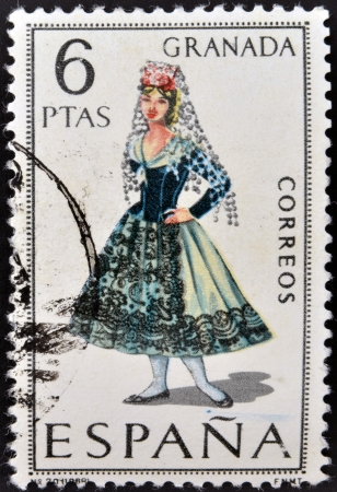 SPAIN - CIRCA 1968: A stamp printed in Spain dedicated to Provincial Costumes shows a woman from Granada, circa 1968 Stock Photo - 20009644