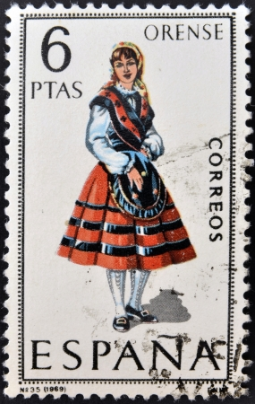 orense: SPAIN - CIRCA 1969: A stamp printed in Spain dedicated to Provincial Costumes shows a woman from Orense, circa 1969 Stock Photo