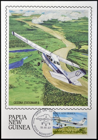 PAPUA NEW GUINEA - CIRCA 1987: A stamp printed in Papua shows A Cessna Stationair in flight over of Momase Region, circa 1987