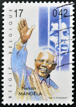 philately: BELGIUM - CIRCA 1999: A stamp printed in Belgium showing an image of Nelson Mandela, circa 1999.  Editorial