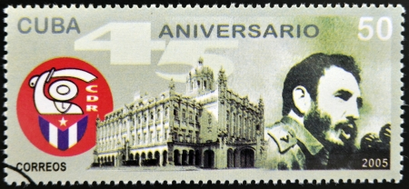 CUBA - CIRCA 2005: Stamp printed in Cuba dedicated to defense committees of the Revolution, shows Fidel Castro and historical building of the havana, circa 2005