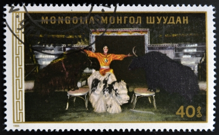streight: MONGOLIA - CIRCA 1986: A stamp printed in Mongolia shows Man with bulls, circa 1986