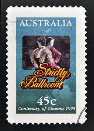 strictly: AUSTRALIA - CIRCA 1995: A stamp printed in Australia commemorating centenary of cinema, shows film strictly ballroom, circa 1995