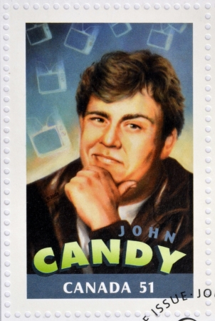 silent film: CANADA - CIRCA 2006: A stamp printed in Canada dedicated to  Canadian actors who have succeeded in Hollywood shows John Candy, circa 2006  Editorial